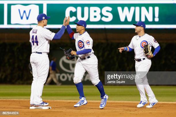 Anthony Rizzo Jon Jay and Albert Almora Jr #5 of the Chicago Cubs celebrate after beating the Los Angeles Dodgers 32 in game four of the National...
