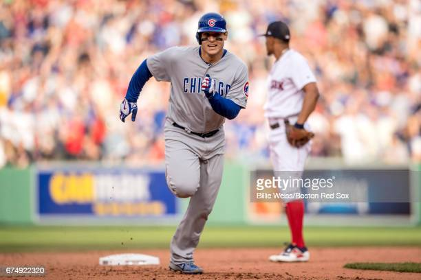 Anthony Rizzo of the Chicago Cubs advances to third base on a passed ball during the seventh inning of a game against the Boston Red Sox on April 29...