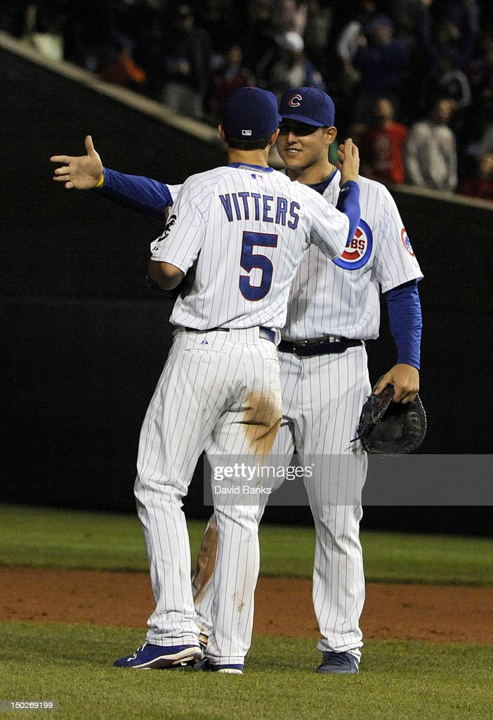 Anthony Rizzo #44 of the Chicago Cubs and Josh Vitters #5 celebrate the Cubs win over the Houston Astros on August 13, 2012 at Wrigley Field in Chicago, Illinois. the Chicago Cubs defeated the Houston Astros 7-1.