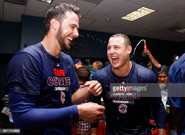 Anthony Rizzo of the Chicago Cubs and Kris Bryant celebrate in the locker room after defeating the Pittsburgh Pirates in the National League Wild...