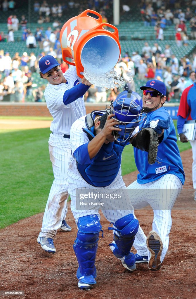 <a gi-track='captionPersonalityLinkClicked' href=/galleries/search?phrase=Anthony+Rizzo&family=editorial&specificpeople=7551494 ng-click='$event.stopPropagation()'>Anthony Rizzo</a> #44 of the Chicago Cubs (L) and <a gi-track='captionPersonalityLinkClicked' href=/galleries/search?phrase=Matt+Garza&family=editorial&specificpeople=835829 ng-click='$event.stopPropagation()'>Matt Garza</a> #22 (R) attack teammate <a gi-track='captionPersonalityLinkClicked' href=/galleries/search?phrase=Dioner+Navarro&family=editorial&specificpeople=593062 ng-click='$event.stopPropagation()'>Dioner Navarro</a> #30 with water and shaving cream as he is interviewed after the game against the Chicago White Sox at Wrigley Field on May 29, 2013 in Chicago, Illinois. Navarro hit three home runs in the game as the Cubs defeated the White Sox 9-3.