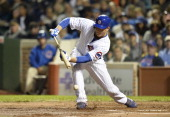 Anthony Rizzo of the Chicago Cubs attempts to bunt during the fourth inning against the Pittsburgh Pirates at Wrigley Field on September 23 2013 in...