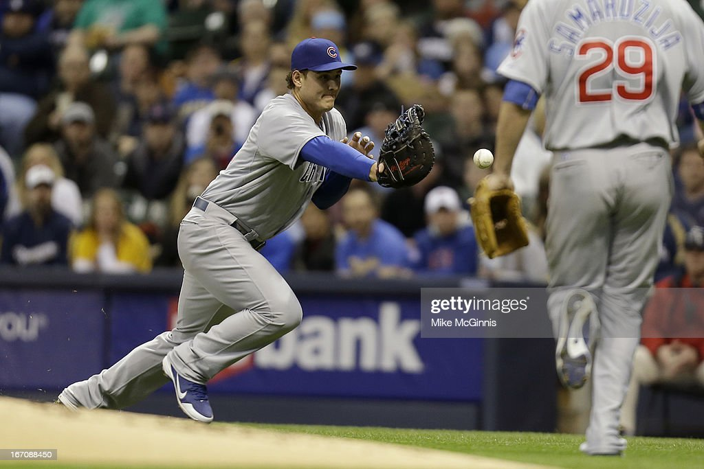 <a gi-track='captionPersonalityLinkClicked' href=/galleries/search?phrase=Anthony+Rizzo&family=editorial&specificpeople=7551494 ng-click='$event.stopPropagation()'>Anthony Rizzo</a> #44 of the Chicago Cubs bobbles the ball allowing Norichika Aoki of the Milwaukee Brewers a base hit in the bottom of the first inning at Miller Park on April 19, 2013 in Milwaukee, Wisconsin.