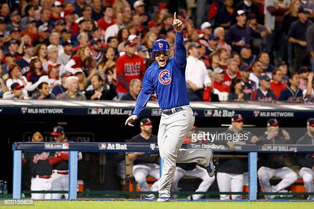 Anthony Rizzo of the Chicago Cubs celebrates after Addison Russell hit a tworun RBI double during the first inning against the Cleveland Indians in...