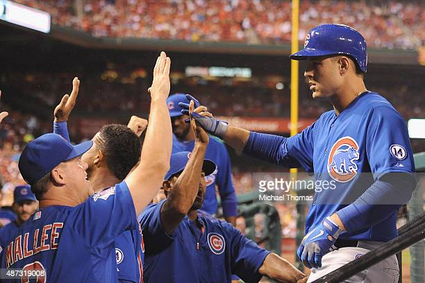 Anthony Rizzo of the Chicago Cubs celebrates after hitting a two run homerun in the first inning at Busch Stadium on September 8 2015 in St Louis...