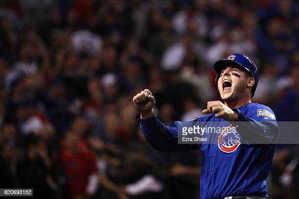 Anthony Rizzo of the Chicago Cubs celebrates after Rizzo scores a run in the 10th inning on a Miguel Montero against the Cleveland Indians in Game...