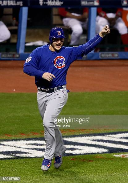 Anthony Rizzo of the Chicago Cubs celebrates after scoring a run on a grand slam home run hit by Addison Russell during the third inning against the...