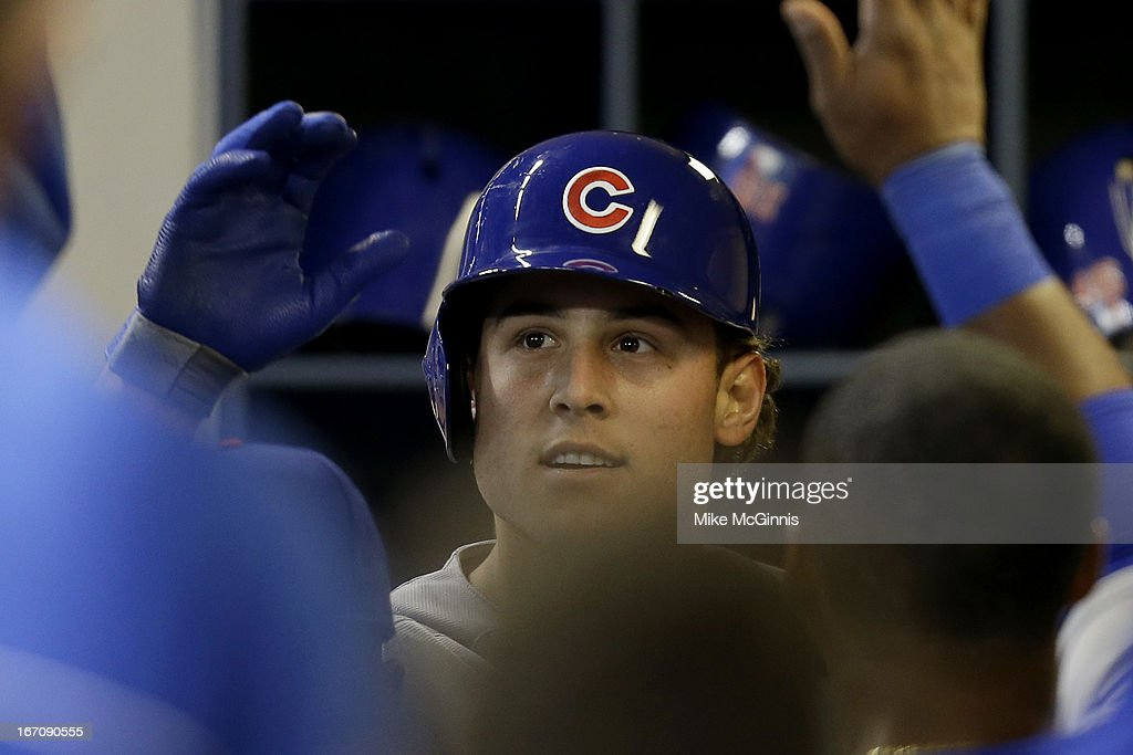 <a gi-track='captionPersonalityLinkClicked' href=/galleries/search?phrase=Anthony+Rizzo&family=editorial&specificpeople=7551494 ng-click='$event.stopPropagation()'>Anthony Rizzo</a> #44 of the Chicago Cubs celebrates in the dugout after hitting a solo home run in the top of the 8th inning against the Milwaukee Brewers at Miller Park on April 19, 2013 in Milwaukee, Wisconsin.