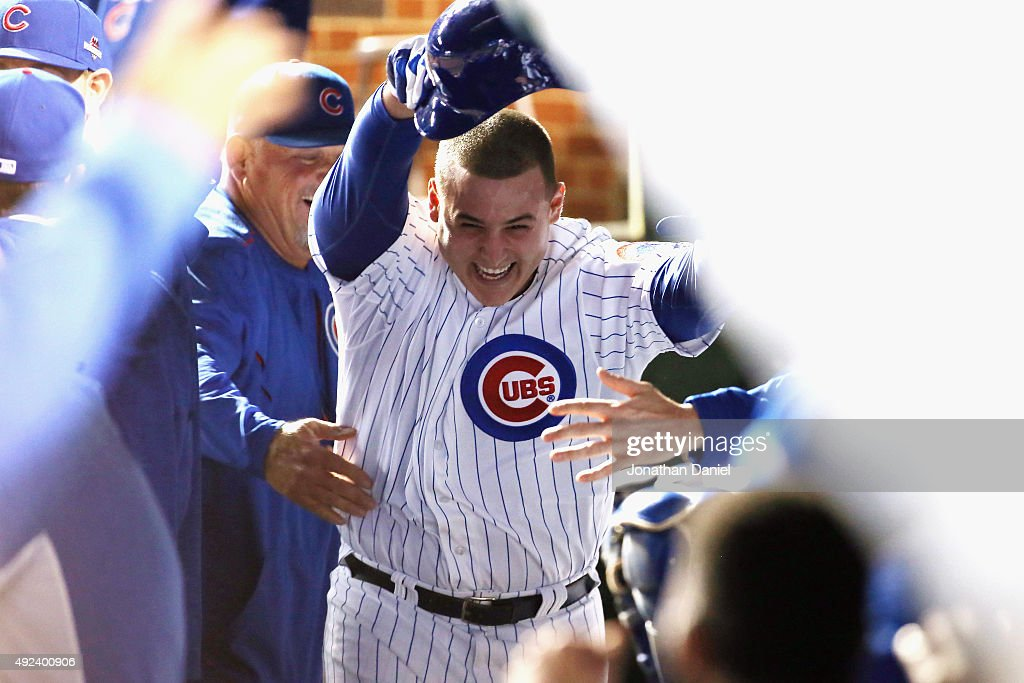 Anthony Rizzo #44 of the Chicago Cubs celebrates in the dugout after hitting a solo home run in the fifth inning against the St. Louis Cardinals during game three of the National League Division Series at Wrigley Field on October 12, 2015 in Chicago, Illinois.