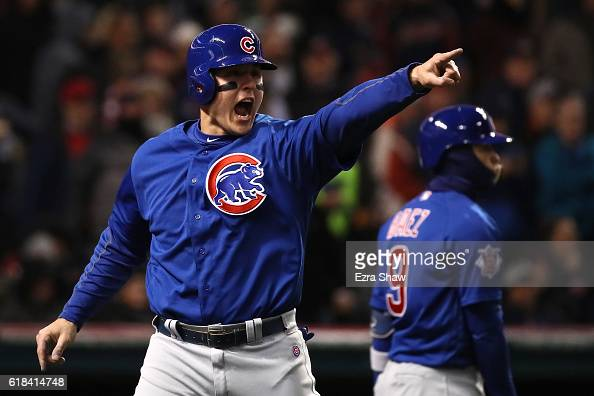 Anthony Rizzo of the Chicago Cubs celebrates scoring a run on an RBI single hit by Kyle Schwarber during the third inning in Game Two of the 2016...