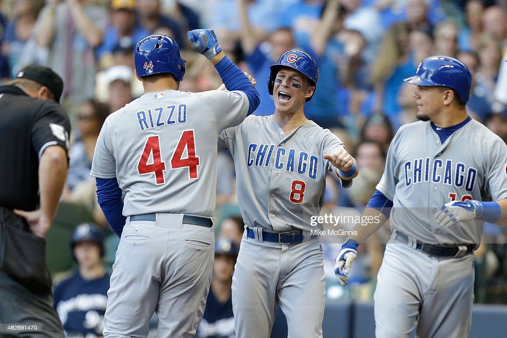 <a gi-track='captionPersonalityLinkClicked' href=/galleries/search?phrase=Anthony+Rizzo&family=editorial&specificpeople=7551494 ng-click='$event.stopPropagation()'>Anthony Rizzo</a> #44 of the Chicago Cubs celebrates with <a gi-track='captionPersonalityLinkClicked' href=/galleries/search?phrase=Chris+Coghlan&family=editorial&specificpeople=4391543 ng-click='$event.stopPropagation()'>Chris Coghlan</a> #8 and <a gi-track='captionPersonalityLinkClicked' href=/galleries/search?phrase=Kyle+Schwarber&family=editorial&specificpeople=10982366 ng-click='$event.stopPropagation()'>Kyle Schwarber</a> #12 after hitting a three run homer in the third inning against the Milwaukee Brewers at Miller Park on August 01, 2015 in Milwaukee, Wisconsin.