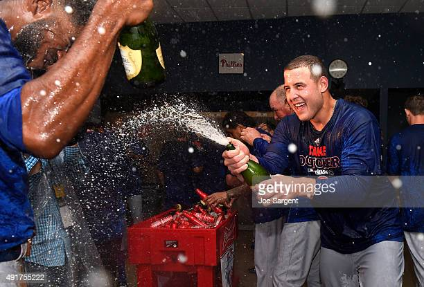 Anthony Rizzo of the Chicago Cubs celebrates with Dexter Fowler after defeating the Pittsburgh Pirates 40 in the National League Wild Card Game on...