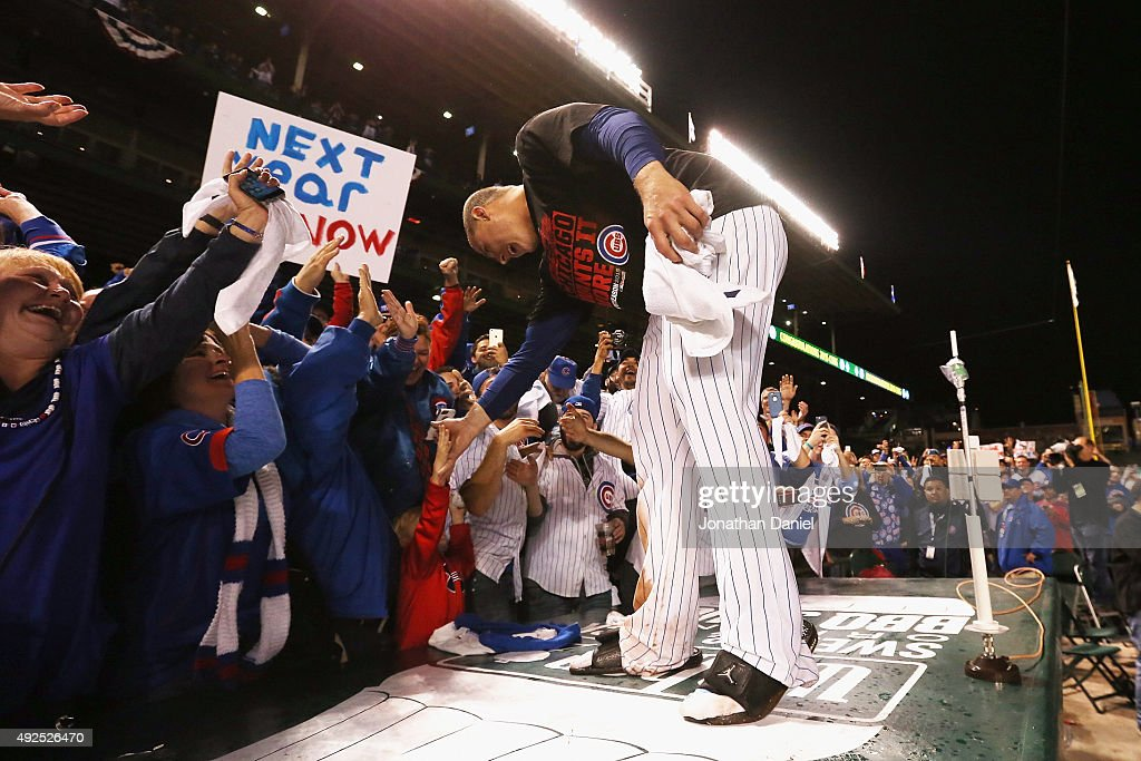 Anthony Rizzo #44 of the Chicago Cubs celebrates with fans after defeating the St. Louis Cardinals in game four of the National League Division Series to win the NLDS 3-1 at Wrigley Field on October 13, 2015 in Chicago, Illinois. The Chicago Cubs defeat the St. Louis Cardinals with a score of 6 to 4.
