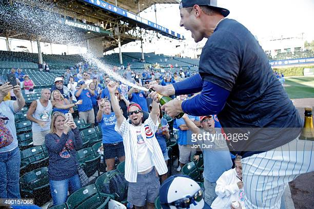 Anthony Rizzo of the Chicago Cubs celebrates with fans after clinching their wildcard playoff position at Wrigley Field on September 26 2015 in...