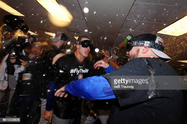 Anthony Rizzo of the Chicago Cubs celebrates with teammates in the clubhouse after winning Game 5 of the National League Division Series 98 against...