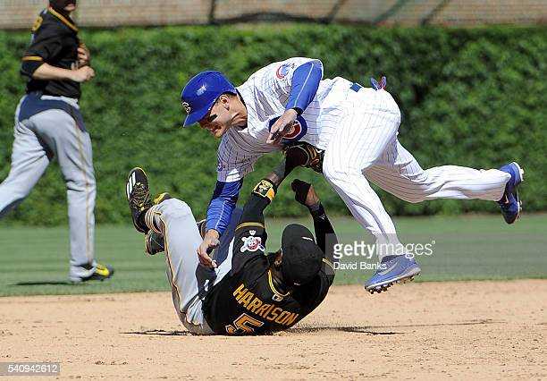 Anthony Rizzo of the Chicago Cubs collides with Josh Harrison of the Pittsburgh Pirates after being forced out during the seventh inning on June 17...