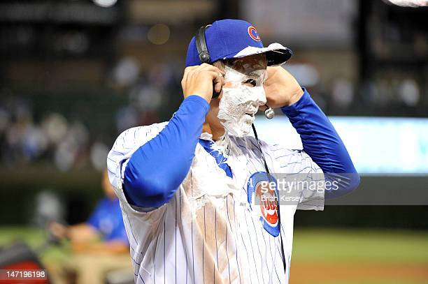 Anthony Rizzo of the Chicago Cubs continues his television interview after begin hit in the face with a shaving cream pie by teammate Matt Garza...