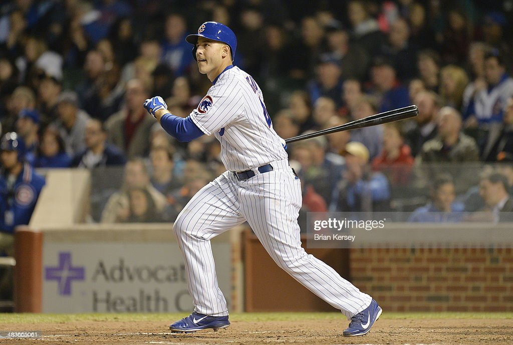 <a gi-track='captionPersonalityLinkClicked' href=/galleries/search?phrase=Anthony+Rizzo&family=editorial&specificpeople=7551494 ng-click='$event.stopPropagation()'>Anthony Rizzo</a> #44 of the Chicago Cubs follows through on an RBI double scoring teammate Emilio Bonifacio #64 during the sixth inning against the Pittsburgh Pirates at Wrigley Field on April 9, 2014 in Chicago, Illinois.