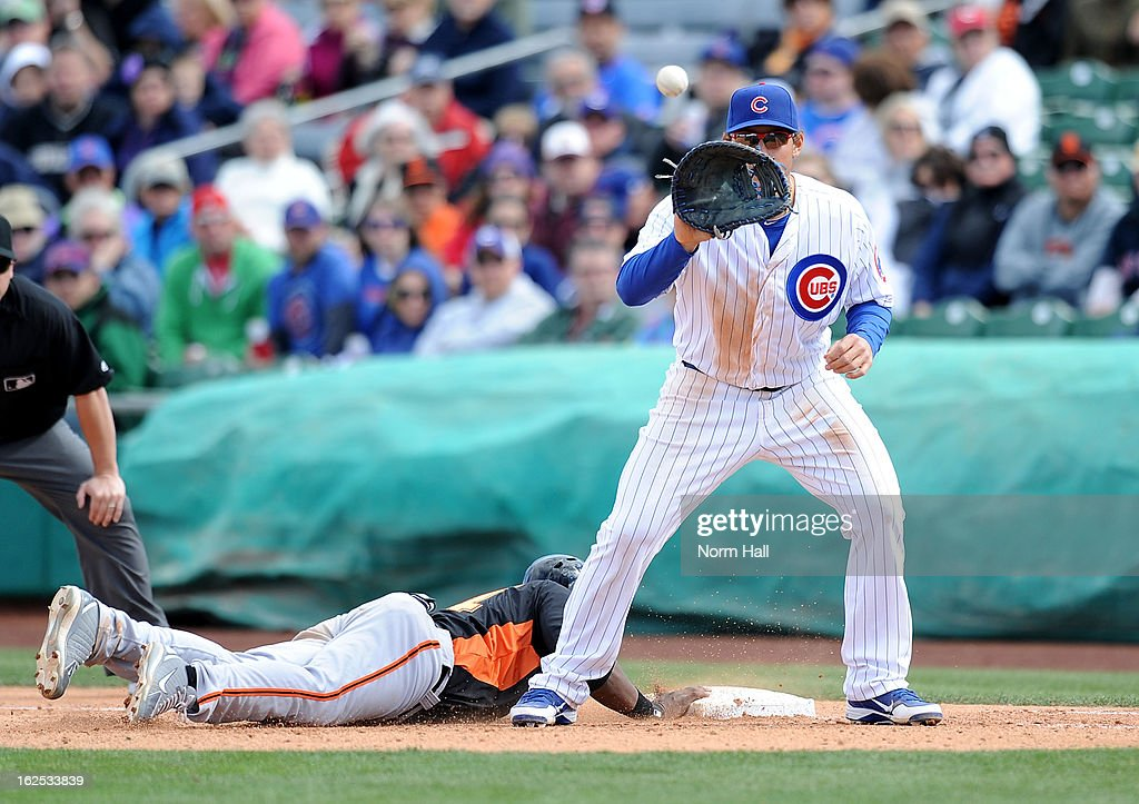 <a gi-track='captionPersonalityLinkClicked' href=/galleries/search?phrase=Anthony+Rizzo&family=editorial&specificpeople=7551494 ng-click='$event.stopPropagation()'>Anthony Rizzo</a> #44 of the Chicago Cubs gets ready to catch a throw from the pitcher as Francisco Peguero #14 of the San Francisco Giants dives back into first base at HoHoKam Park on February 24, 2013 in Mesa, Arizona.
