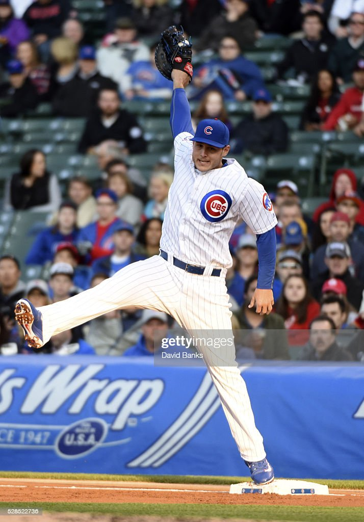 <a gi-track='captionPersonalityLinkClicked' href=/galleries/search?phrase=Anthony+Rizzo&family=editorial&specificpeople=7551494 ng-click='$event.stopPropagation()'>Anthony Rizzo</a> #44 of the Chicago Cubs has to make a stretch on a throw from Addison Russell #27 of the Chicago Cubs during the first inning against the Washington Nationals on May 5, 2016 at Wrigley Field in Chicago, Illinois.