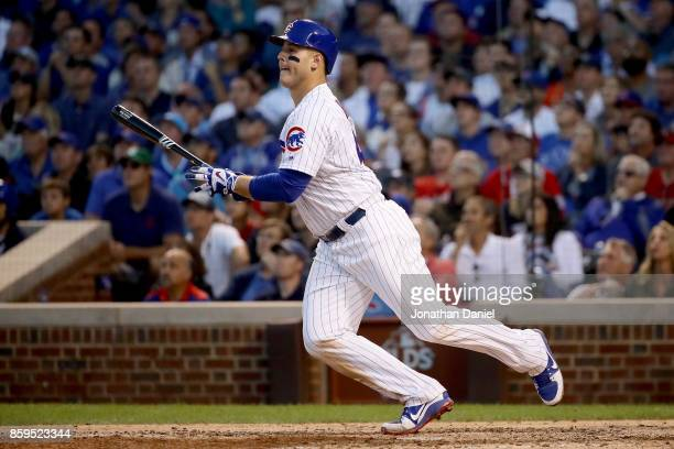 Anthony Rizzo of the Chicago Cubs hits a single in the eighth inning against the Washington Nationals during game three of the National League...