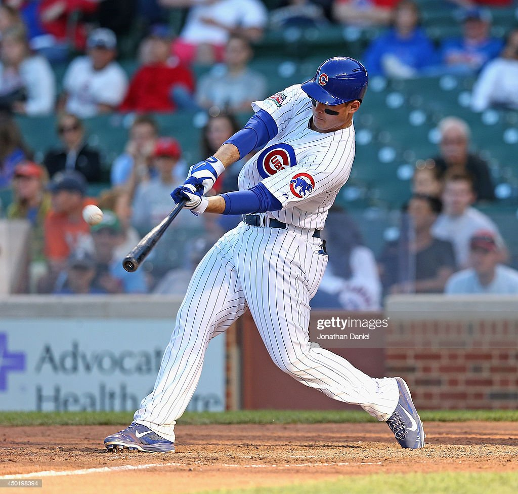 <a gi-track='captionPersonalityLinkClicked' href=/galleries/search?phrase=Anthony+Rizzo&family=editorial&specificpeople=7551494 ng-click='$event.stopPropagation()'>Anthony Rizzo</a> #44 of the Chicago Cubs hits a walk-off, two-run home run in the 13th inning to beat the Miami Marlins at Wrigley Field on June 6, 2014 in Chicago, Illinois. The Cubs defeated the Marlins 5-3 in 13 innings.