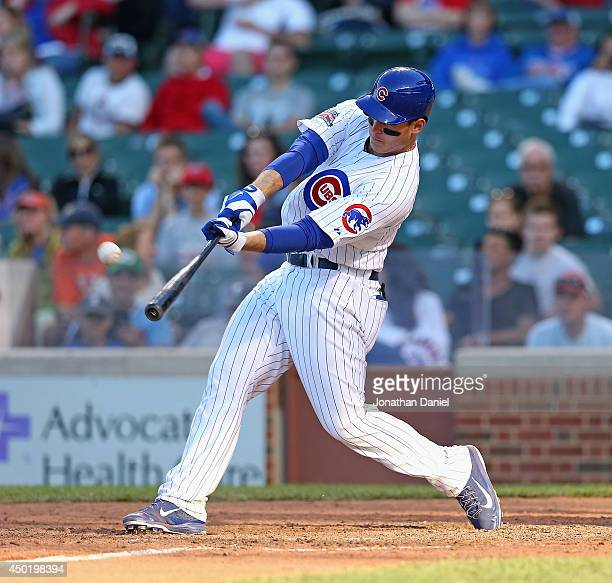Anthony Rizzo of the Chicago Cubs hits a walkoff tworun home run in the 13th inning to beat the Miami Marlins at Wrigley Field on June 6 2014 in...