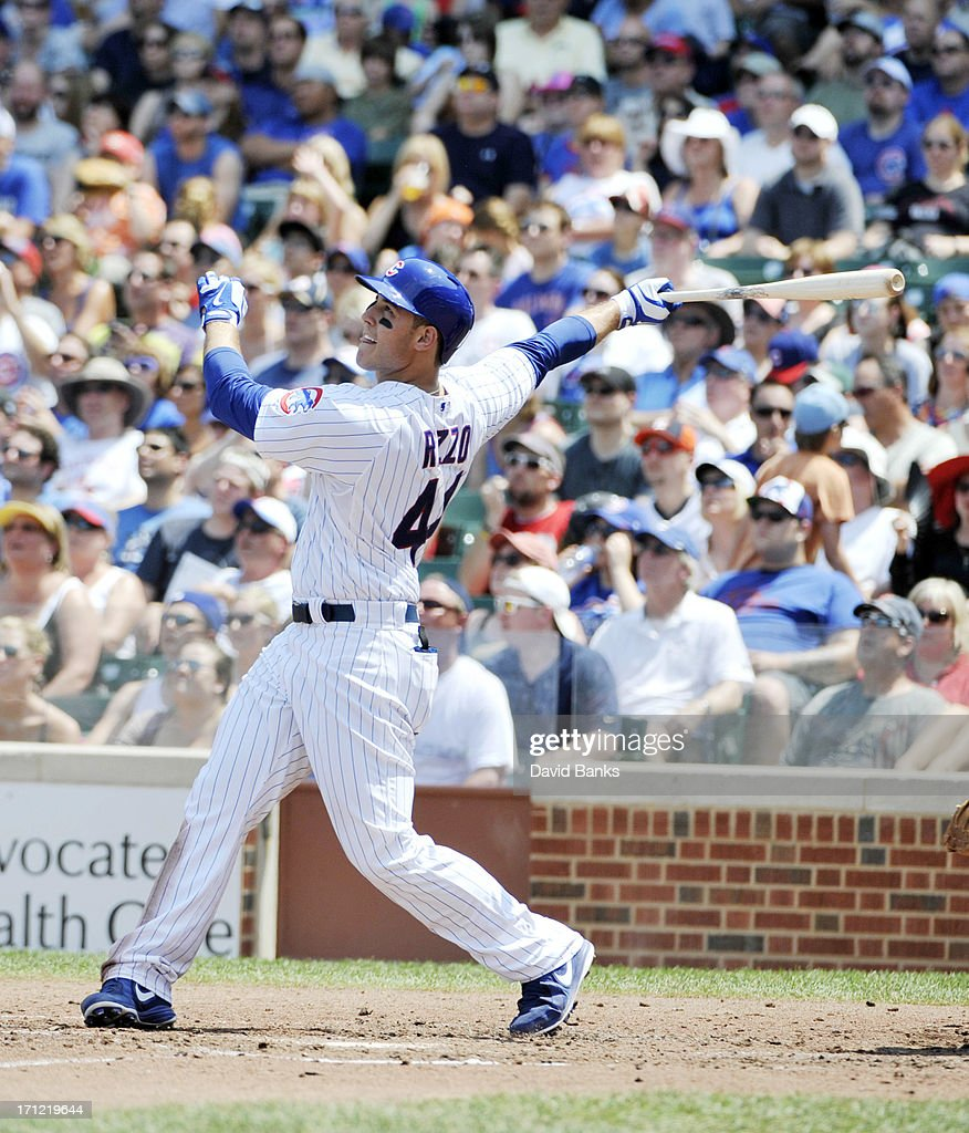 Anthony Rizzo #44 of the Chicago Cubs hits an RBI sacrifice fly against the Houston Astros during the third inning on June 23, 2013 at Wrigley Field in Chicago, Illinois.