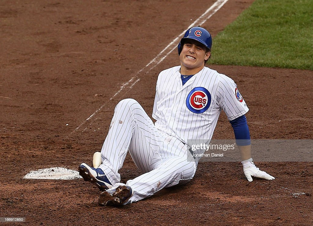 <a gi-track='captionPersonalityLinkClicked' href=/galleries/search?phrase=Anthony+Rizzo&family=editorial&specificpeople=7551494 ng-click='$event.stopPropagation()'>Anthony Rizzo</a> #44 of the Chicago Cubs hits the ground after being hit by a pitch while batting against the Texas Rangers at Wrigley Field on April 18, 2013 in Chicago, Illinois.