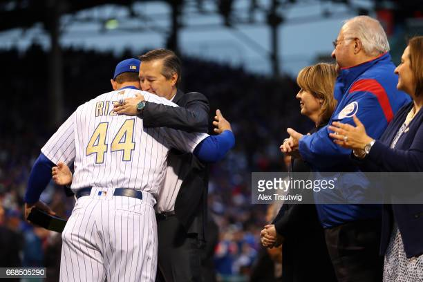 Anthony Rizzo of the Chicago Cubs hugs owner Tom Ricketts during the World Series ring ceremony ahead of the game between the Los Angeles Dodgers and...