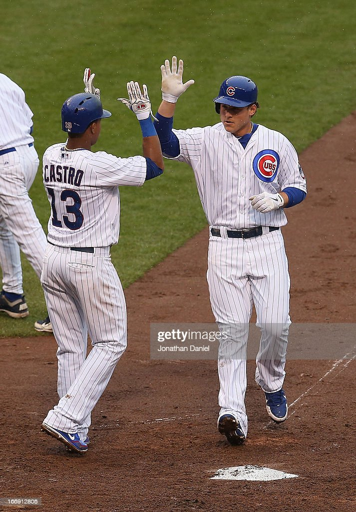 Anthony Rizzo #44 of the Chicago Cubs is congratulated by teammate <a gi-track='captionPersonalityLinkClicked' href=/galleries/search?phrase=Starlin+Castro&family=editorial&specificpeople=5970945 ng-click='$event.stopPropagation()'>Starlin Castro</a> #13 after hitting a two-run home run in the 3rd inning against the Texas Rangers at Wrigley Field on April 18, 2013 in Chicago, Illinois.