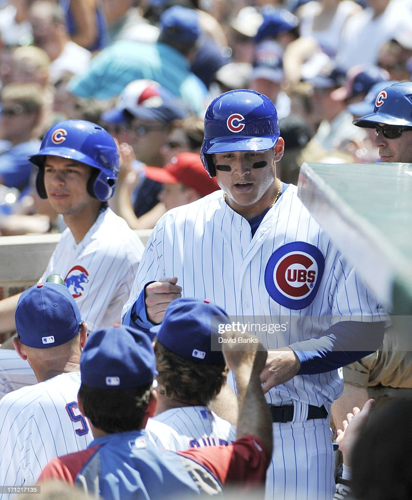 Anthony Rizzo #44 of the Chicago Cubs is greeted after scoring against the Houston Astros during the second inning on June 23, 2013 at Wrigley Field in Chicago, Illinois.