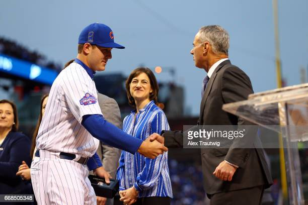 Anthony Rizzo of the Chicago Cubs is greeted by Commissioner of Baseball Robert D Manfred Jr during the World Series ring ceremony ahead of the game...