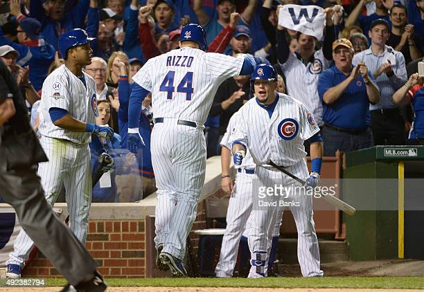 Anthony Rizzo of the Chicago Cubs is greeted by Kyle Schwarber of the Chicago Cubs after hitting a solo home run in the fifth inning against the St...
