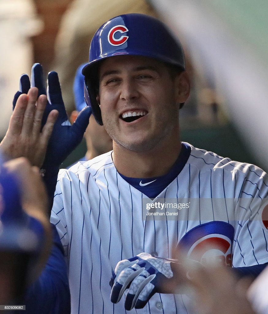 Anthony Rizzo #44 of the Chicago Cubs is greeted in the dugout after hitting a grand slam home run in the 1st inning against the Cincinnati Reds at Wrigley Field on August 16, 2017 in Chicago, Illinois.