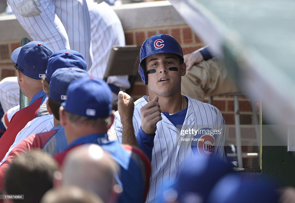 <a gi-track='captionPersonalityLinkClicked' href=/galleries/search?phrase=Anthony+Rizzo&family=editorial&specificpeople=7551494 ng-click='$event.stopPropagation()'>Anthony Rizzo</a> #44 of the Chicago Cubs is greeted in the dugout by his teammates after scoring on a sacrifice fly hit by Nate Schierholtz #19 during the first inning against the Miami Marlins at Wrigley Field on September 2, 2013 in Chicago, Illinois.
