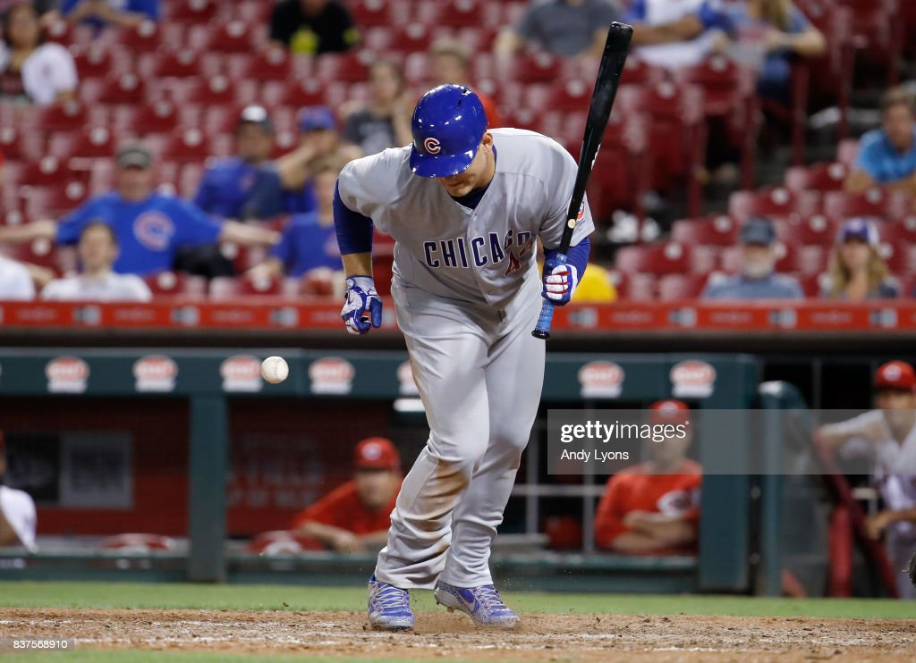 Anthony Rizzo #44 of the Chicago Cubs is hit by a pitch in the 9th inning against the Cincinnati Reds at Great American Ball Park on August 22, 2017 in Cincinnati, Ohio.