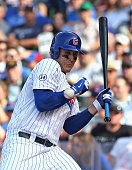 Anthony Rizzo of the Chicago Cubs is hit on the wrist by a pitch in the 8th inning against the Philadelphia Phillies at Wrigley Field on July 24 2015...