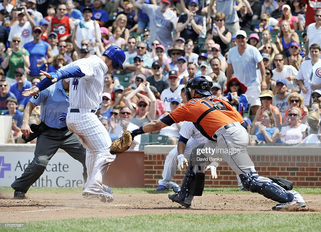 Anthony Rizzo #44 of the Chicago Cubs is safe at home as Jason Castro #15 of the Houston Astros makes a late tag during the fifth inning on June 23, 2013 at Wrigley Field in Chicago, Illinois.