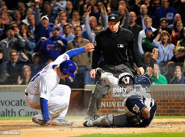 Anthony Rizzo of the Chicago Cubs is safe at home as Martin Maldonado of the Milwaukee Brewers tries to make a tag during the second inningon...