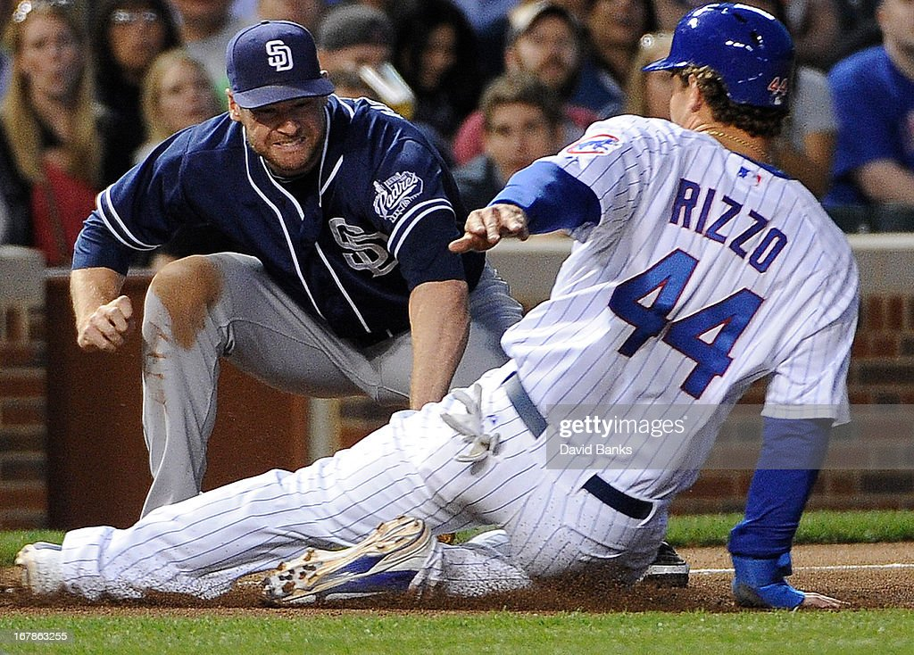 <a gi-track='captionPersonalityLinkClicked' href=/galleries/search?phrase=Anthony+Rizzo&family=editorial&specificpeople=7551494 ng-click='$event.stopPropagation()'>Anthony Rizzo</a> #44 of the Chicago Cubs is safe at third base on a fielder's choice as <a gi-track='captionPersonalityLinkClicked' href=/galleries/search?phrase=Chase+Headley&family=editorial&specificpeople=4353228 ng-click='$event.stopPropagation()'>Chase Headley</a> #7 of the San Diego Padres makes a late tag during the third inning on May 1, 2013 at Wrigley Field in Chicago, Illinois.