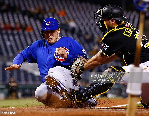 Anthony Rizzo of the Chicago Cubs is tagged out at home plate by Francisco Cervelli in the fifth inning during the game at PNC Park on April 20 2015...
