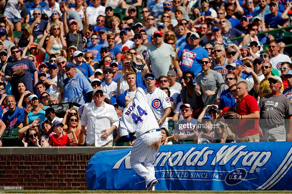 <a gi-track='captionPersonalityLinkClicked' href=/galleries/search?phrase=Anthony+Rizzo&family=editorial&specificpeople=7551494 ng-click='$event.stopPropagation()'>Anthony Rizzo</a> #44 of the Chicago Cubs makes a catch for an out in foul territory against the Philadelphia Phillies during the seventh inning at Wrigley Field on May 29, 2016 in Chicago, Illinois.