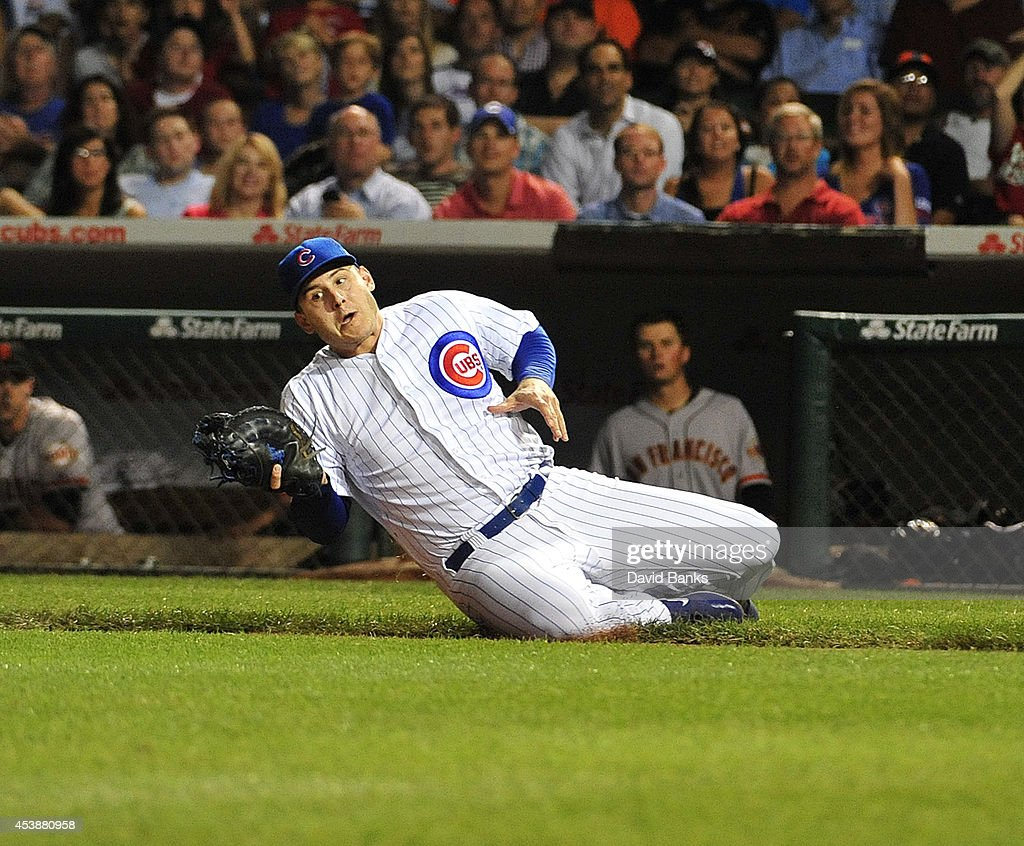 <a gi-track='captionPersonalityLinkClicked' href=/galleries/search?phrase=Anthony+Rizzo&family=editorial&specificpeople=7551494 ng-click='$event.stopPropagation()'>Anthony Rizzo</a> #44 of the Chicago Cubs makes a catch on Andrew Susac (not pictured) of the San Francisco Giants during the fifth inning on August 20, 2014 at Wrigley Field in Chicago, Illinois.