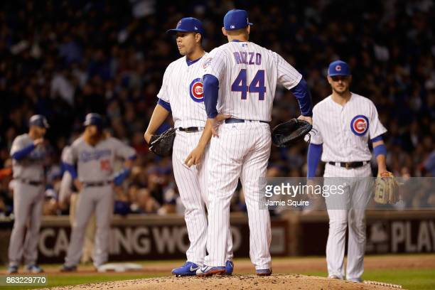 Anthony Rizzo of the Chicago Cubs meets with Jose Quintana in the third inning against the Los Angeles Dodgers during game five of the National...