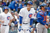 Anthony Rizzo of the Chicago Cubs reacts after being hit by a pitch against the New York Mets during the fourth inning on May 14 2015 at Wrigley...