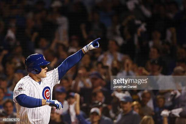 Anthony Rizzo of the Chicago Cubs reacts after hitting a solo home run in the fifth inning against the St Louis Cardinals during game three of the...