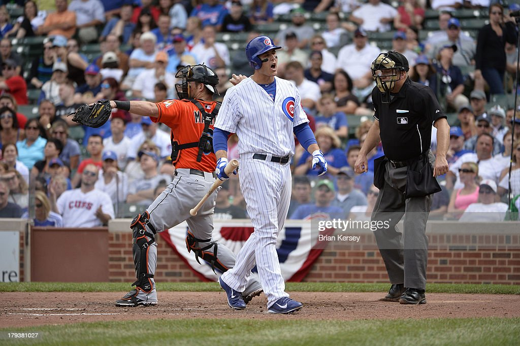 <a gi-track='captionPersonalityLinkClicked' href=/galleries/search?phrase=Anthony+Rizzo&family=editorial&specificpeople=7551494 ng-click='$event.stopPropagation()'>Anthony Rizzo</a> #44 of the Chicago Cubs (C) reacts after striking out as catcher <a gi-track='captionPersonalityLinkClicked' href=/galleries/search?phrase=Jeff+Mathis&family=editorial&specificpeople=660661 ng-click='$event.stopPropagation()'>Jeff Mathis</a> #6 of the Miami Marlins throws the ball back to the pitcher and home plate umpire Jeff Nelson #45 stands on the field during the eighth inning at Wrigley Field on September 2, 2013 in Chicago, Illinois The Marlins defeated the Cubs 4-3.