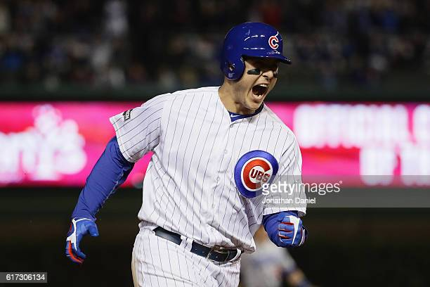 Anthony Rizzo of the Chicago Cubs reacts as he runs the bases after hitting a solo home run in the fifth inning against the Los Angeles Dodgers...