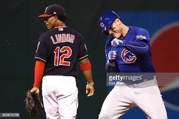 Anthony Rizzo of the Chicago Cubs reacts on second base after hitting an RBI single to score Kris Bryant during the fifth inning against the...